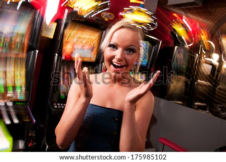 Young woman in Casino on a slot machine - stock photo