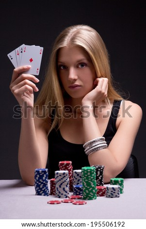 young woman in casino with cards and chips over grey background