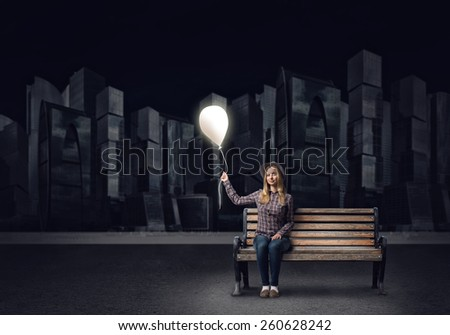 Young woman in casual holding balloon. Idea concept - stock photo