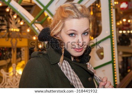 Young woman in Christmas decorations