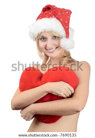 Young woman in Christmas hat with toy heart isolated on white
