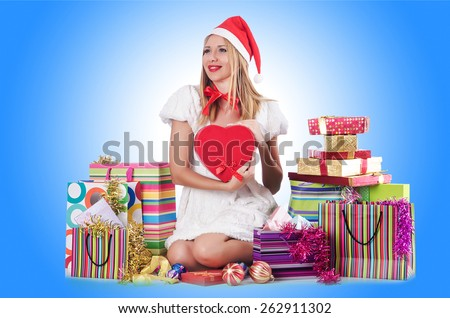 Young woman in christmas shopping concept - stock photo