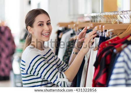 Young woman in clothing store  - stock photo