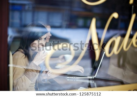 Young woman in coffee shop - stock photo