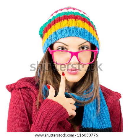 Young woman in colorful winter clothes wondering isolated on white background - stock photo