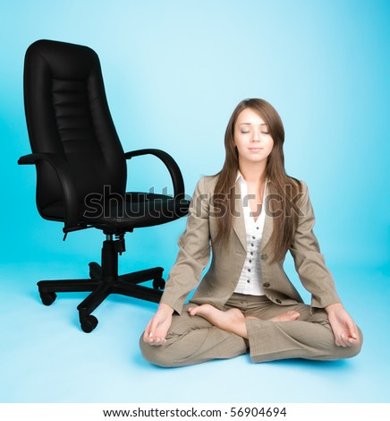 Young woman in costume sitting in lotus pose and meditating - stock photo