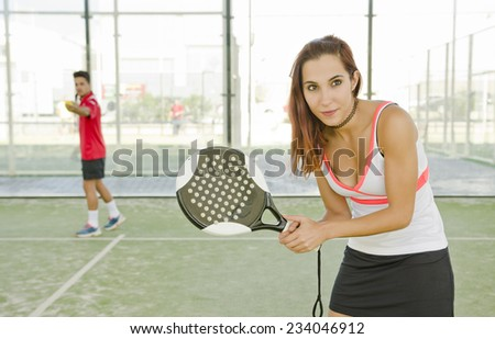 Young woman in court ready for play paddle tennis