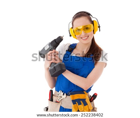 Young woman in  coverall with screwdriver on a white background. Female construction worker. - stock photo