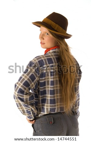 Young woman in cowboy dress looking backward (isolated on white)