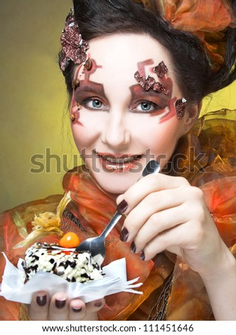 Young woman in creative artistic image with cake