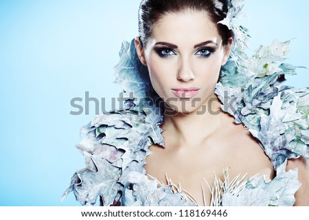 Young woman in creative image with silver artistic make-up. - stock photo