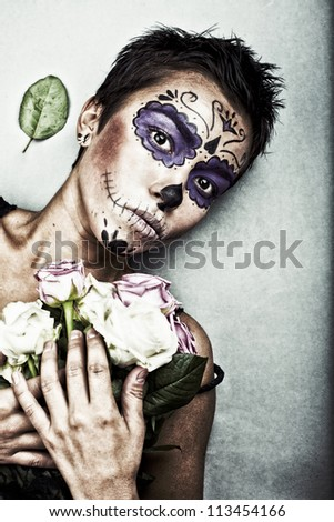 Young woman in  dead mask skull face art - stock photo