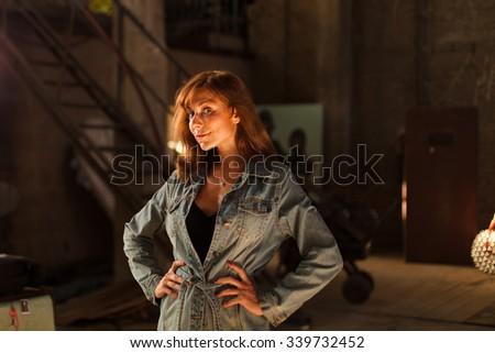 young woman in denim shirt - stock photo