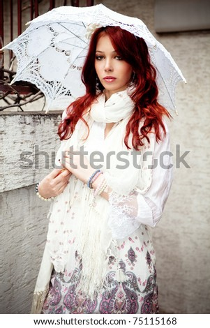 young woman in elgant summer clothes with parasol, outdoor shot - stock photo