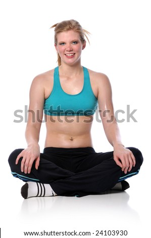 Young woman in exercise outfit sitting isolated over a white background - stock photo