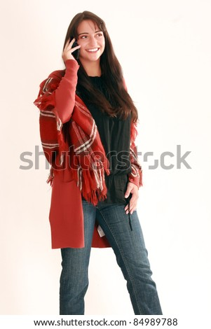 Young woman in fashionable fall clothing when phoning /Young woman telephoned - stock photo