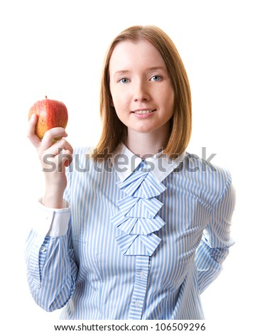 Young woman in formal wear holding apple in her hand, isolated on white - stock photo