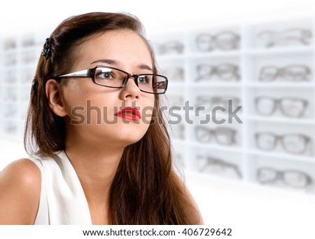 Young woman in glasses at the glasses shop, closeup