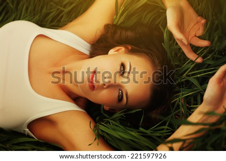 Young woman in grass portrait. - stock photo