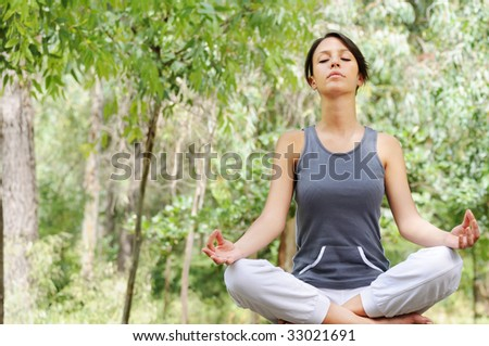 young woman in green forest, yoga and meditation