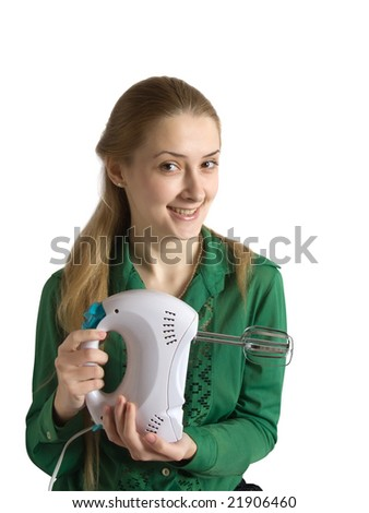 Young woman in green with blender. Isolated - stock photo
