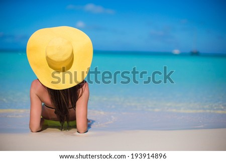 Young woman in hat on the beach enjoy caribbean vacation - stock photo