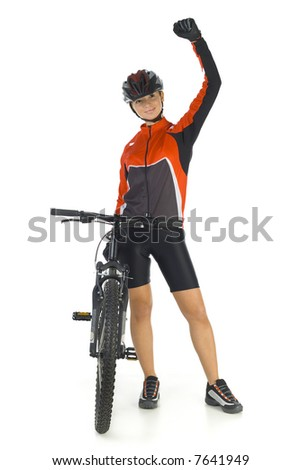 Young woman in helmet, standing with hand up next to mountain bike. Smiling and looking at camera. Isolated on white in studio. Whole body, front view