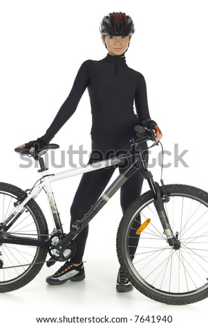 Young woman in helmet, standing with mountain bike. Smiling and looking at camera. White background, front view - stock photo