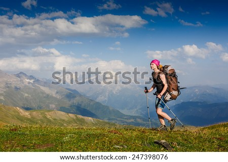Young woman in hike on the trail in the mountain - stock photo