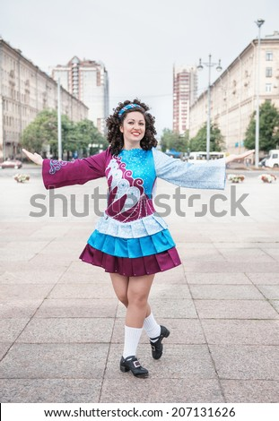 Young woman in irish dance dress posing  - stock photo