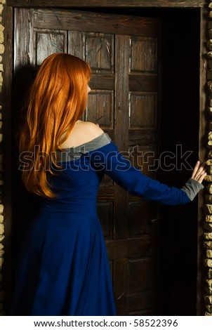 Young woman in italian renaissance dress open door