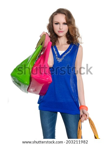 young woman in jeans with colorful bag  - stock photo