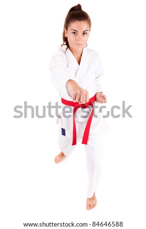 Young woman in karate outfit, isolated over white - stock photo