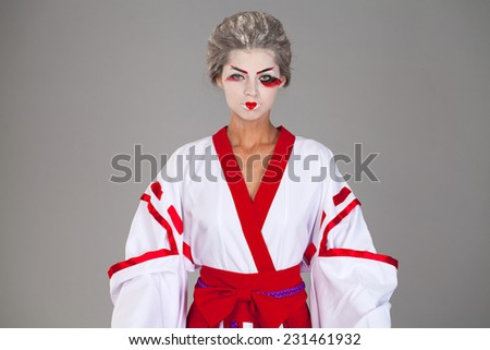 Young woman in Kimono, isolated on gray background  - stock photo