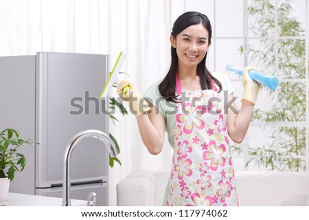 young woman in kitchen - stock photo