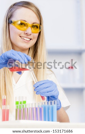 young woman in laboratory - stock photo