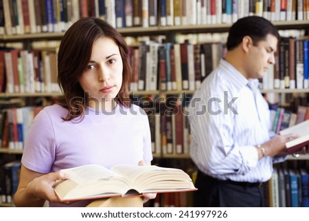 Young Woman in Library - stock photo