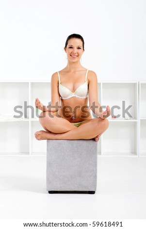 young woman in lingerie yoga - stock photo