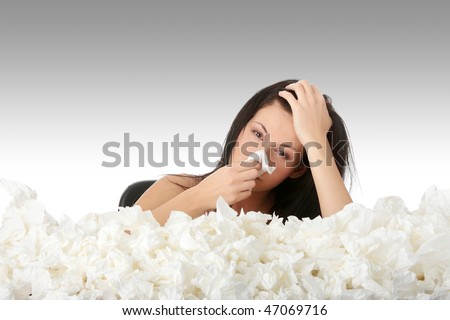 Young woman in lot of tissues around, ill - stock photo