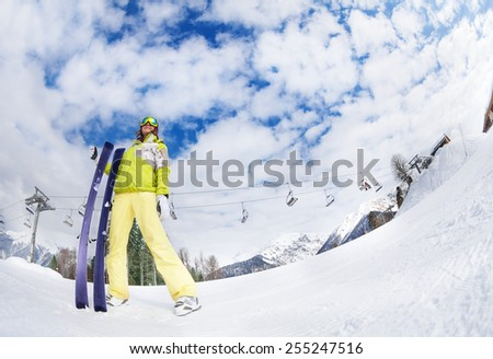 Young woman in mask holding ski fisheye view - stock photo