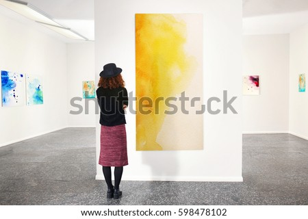 Young woman in modern art gallery
