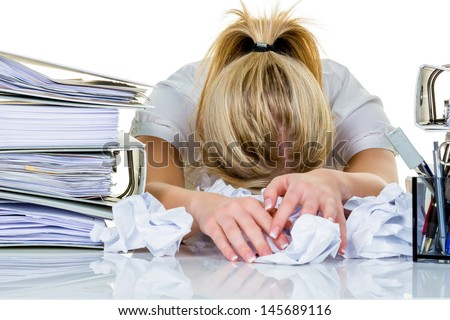 young woman in office is overwhelmed with work. burnout in work or study. - stock photo