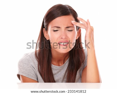 Young woman in pain with closed eyes with headache on white background - stock photo