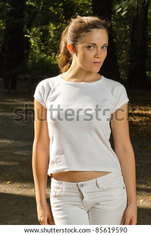 Young woman in park ready for jogging - stock photo
