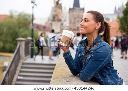 young woman in prague enjoying her day - stock photo