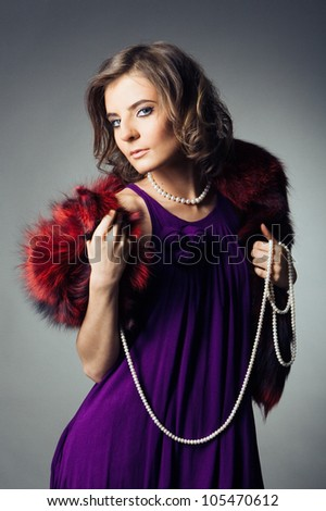 young woman in purple dress with red fur collar in retro style - stock photo