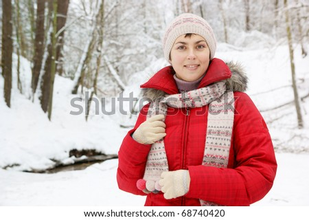 Young woman in red coat outdoor - stock photo