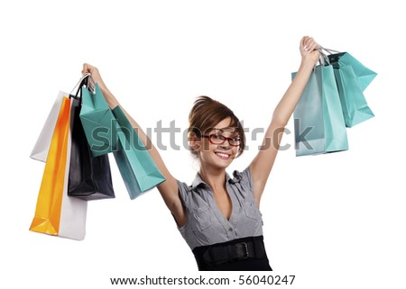 Young woman in red glasses admiring her shopping - stock photo