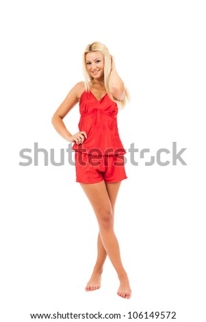 Young woman in red pajamas over white background - stock photo