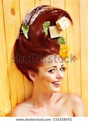 Young woman in sauna with soap. Healthy lifestyle. - stock photo